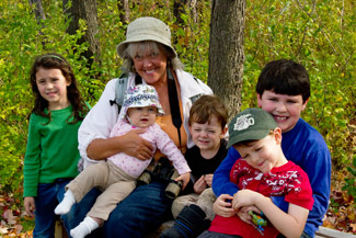 photo of Sue and grandkids